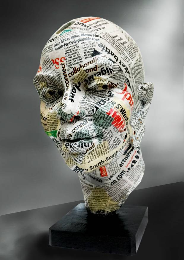 Sculpture head covered in colorful newsprint